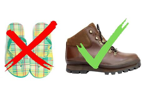 Plaid flip flops and hiking boots.